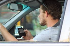 Texting and driving - 30 (Crazy) Things You Will See Driving in Puerto Rico